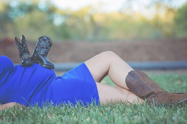 Pregnant woman in cowboy boots